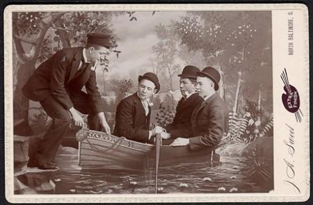 Four men boarding a boat cab