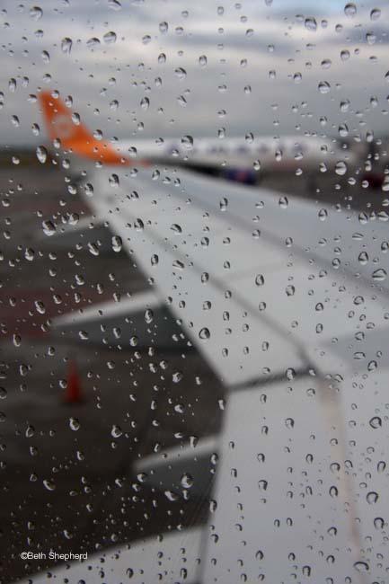 rain on plane window1 Mature romantic couple at seashore by Elena Elisseeva   Stock Photo