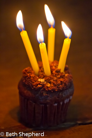 Four candles and a cupcake