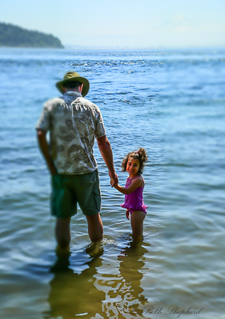 In Puget Sound up to her knees and ready for swimming