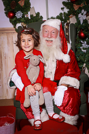 A girl, her bunny and Santa Claus