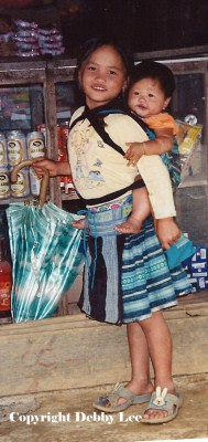 Vietnam Sister Carrying Baby