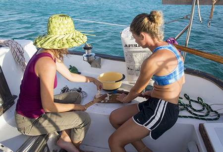 Jessica and Stephanie tenderizing conch in Flamingo Cay