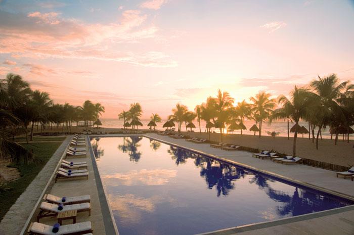 Dreams Tulum pool sunset