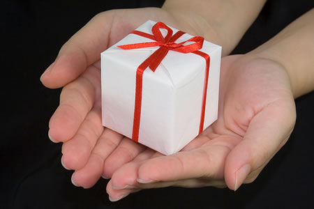 hands presenting gift