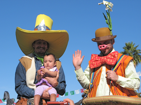 Stilt walkers with baby