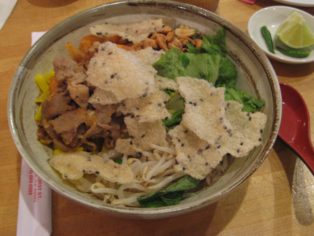 Pork with yellow noodles