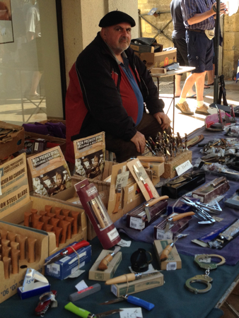 Man with handcuffs, Saturday Market, Sarlat, France