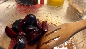 Cooked steel-cut oatmeal with plums