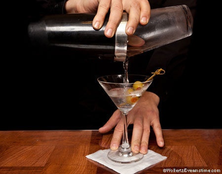 Bartender pouring martini