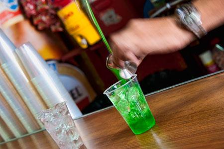 Pouring green rum horiz