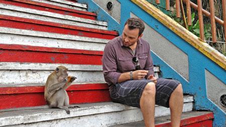 Zane Lamprey and monkey