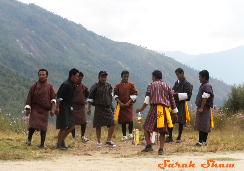 Bhutanese Men in Gho at an archery competition
