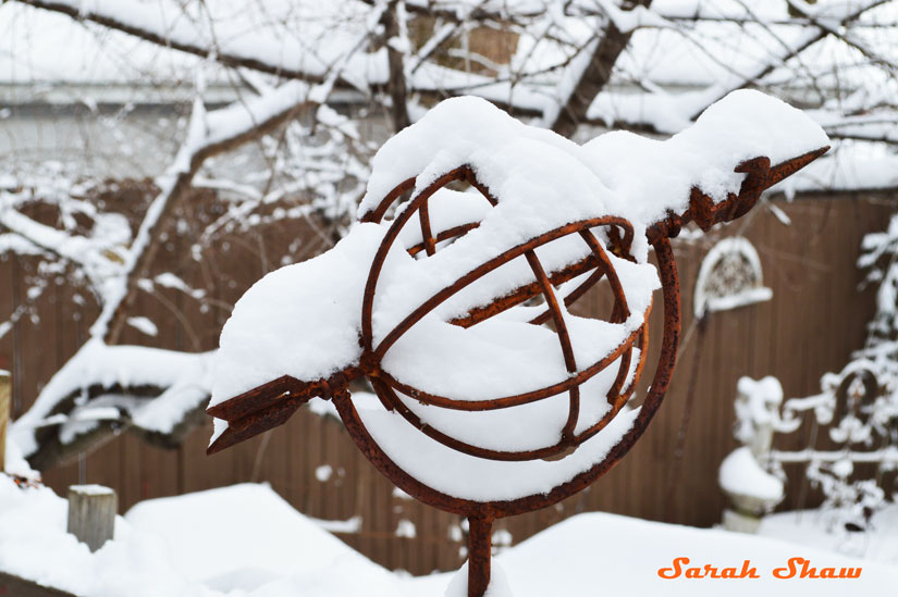 Trellis with armillary in the snow