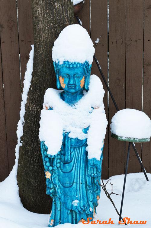 Turquoise Buddha garden statue