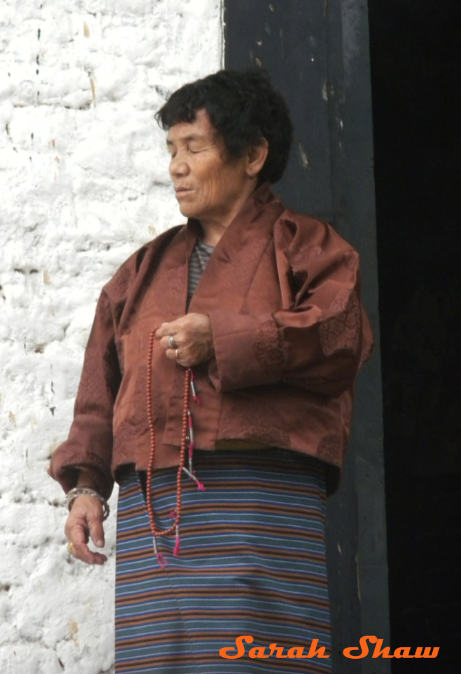 Bhutanese woman uses prayer beads
