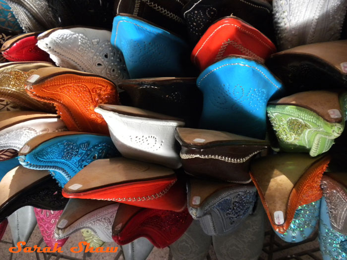 Babouche come in many colors in the market stalls of Marrakesh