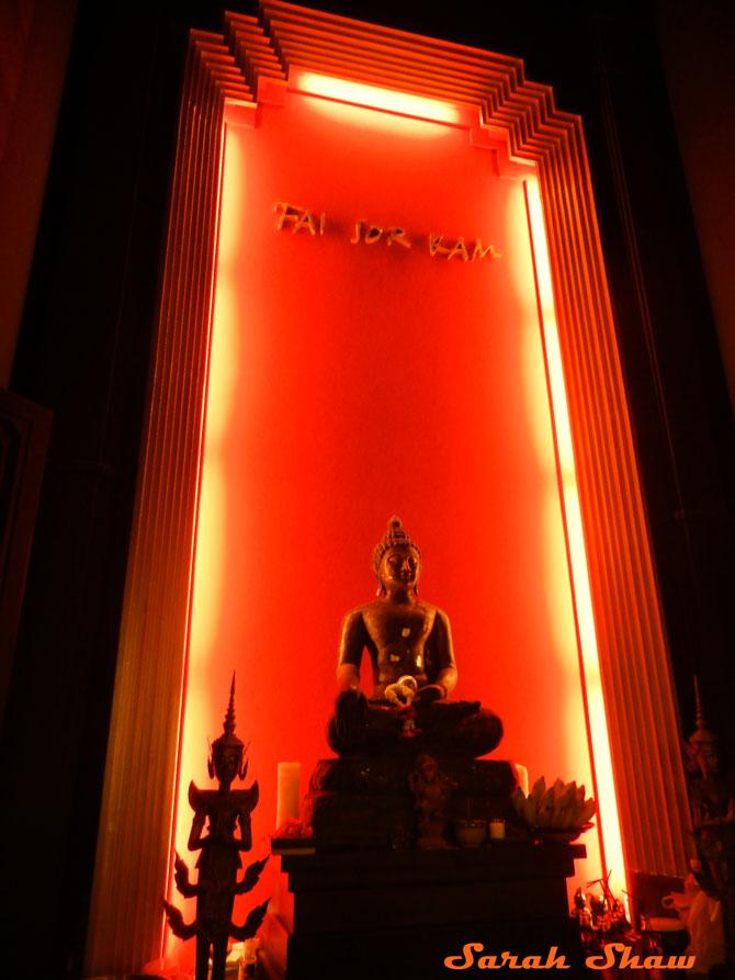 Dramatic lighting with Buddha at Fai Sor Kam
