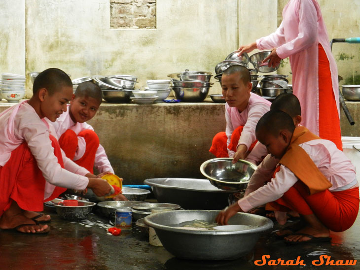 Buddhist nuns wash dishes after lunch at a nunnery outside of Mandalay, Myanmar
