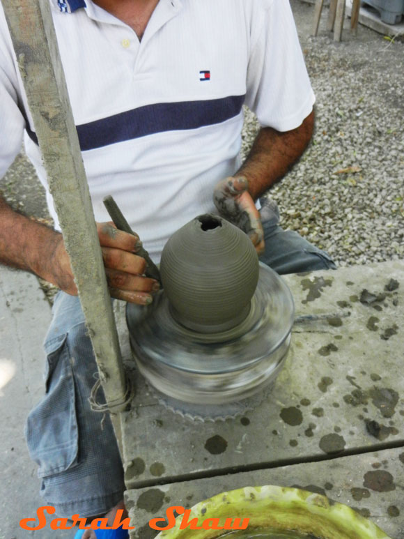 Collapsing the top to create a jar shape in Guatil, Costa Rica