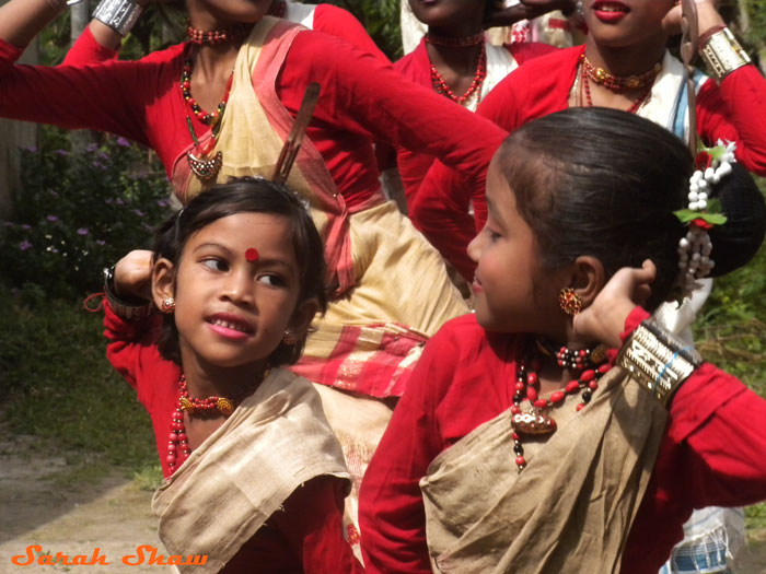 Girl dancers perform in a village in Assam, India