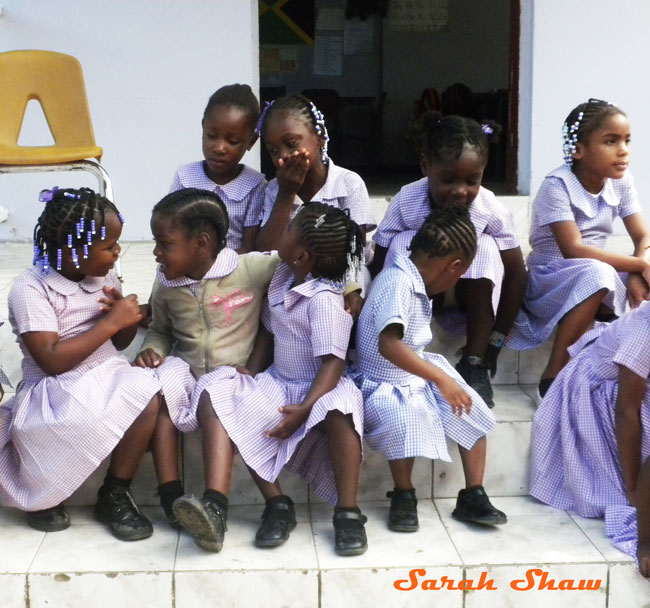 School girls gather outside their Johns Hall classroom in Jamaica
