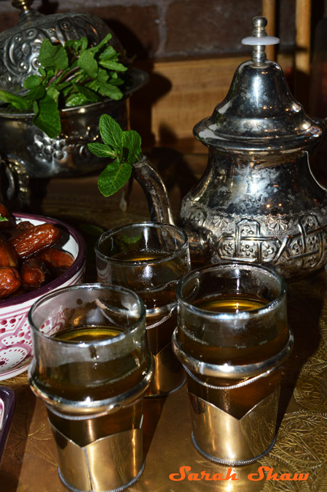 A vintage Moroccan sugar pot holds mint here for the tea party