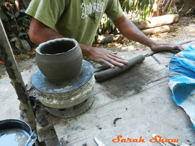Rolling a coil of clay to add to a pot in Guatil, Costa Rica