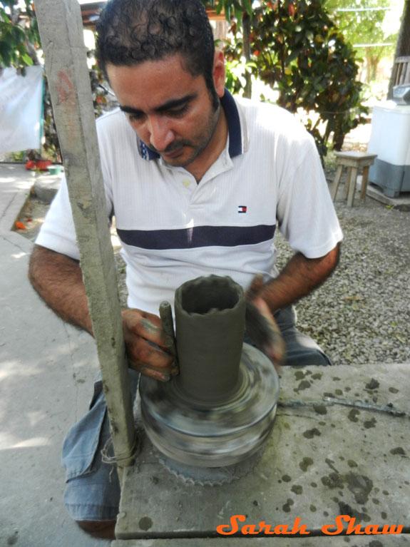 Using a corn cob to shape the pot in Guatil, Costa Rica