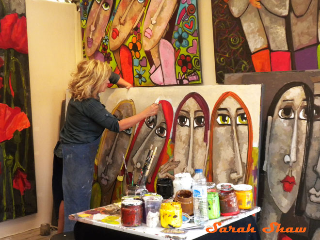 A woman paints at an art fair in Paris, France