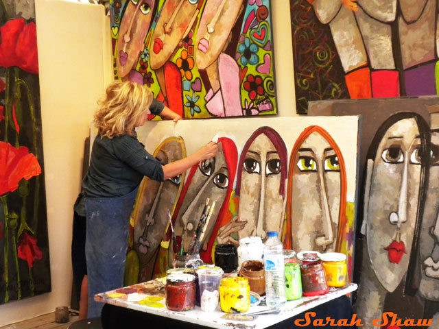 An artist works in her booth at the Bastille Art Fair, Paris, France