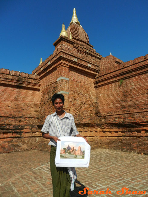Buying a painting atop a temple in Bagan, Myanmar