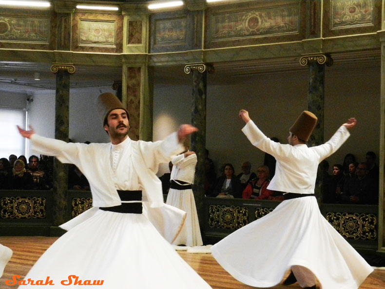 Whirling Devishes during a Sema Ceremony in Istanbul, Turkey
