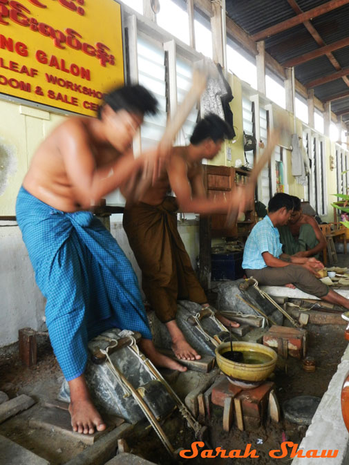 Synchronized hammering for gold leaf in Mandalay, Myanmar
