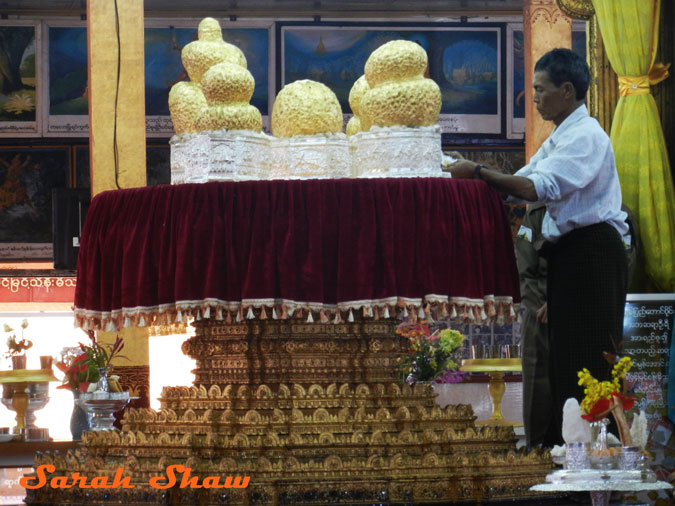 Five Buddhas loaded with gold leaf at a temple in Inle Lake, Myanmar
