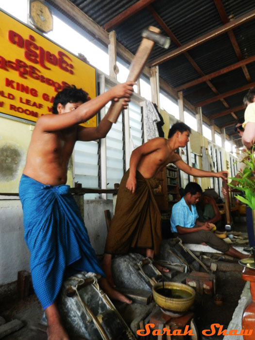 Hammering gold into leaf in Mandalay, Myanmar