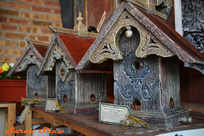 Architectural birdhouses from old barn wood at the Antique and Garden Fair hosted by the Chicago Botanic Garden