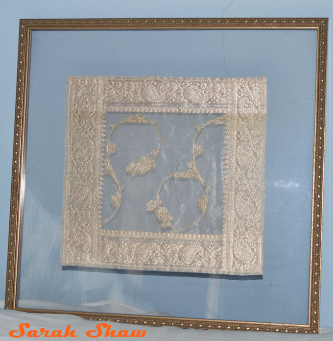 Floated Indian silk is framed for hanging