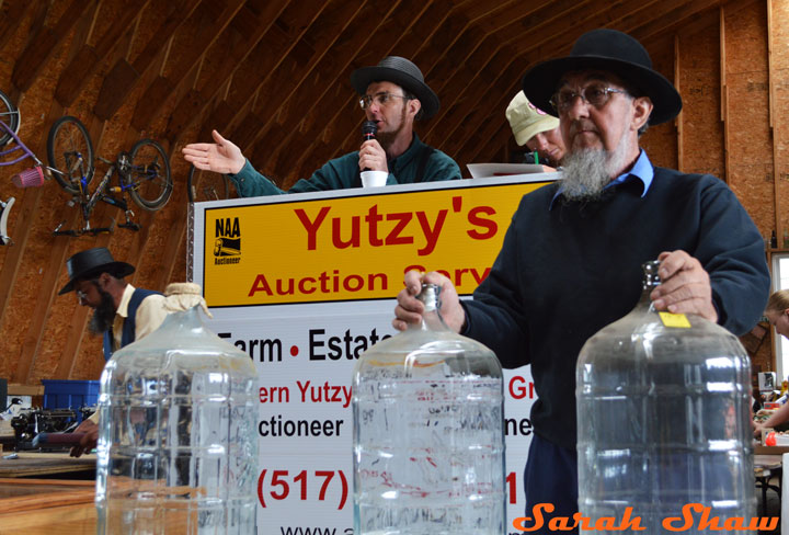 Glass water bottles are auctioned off