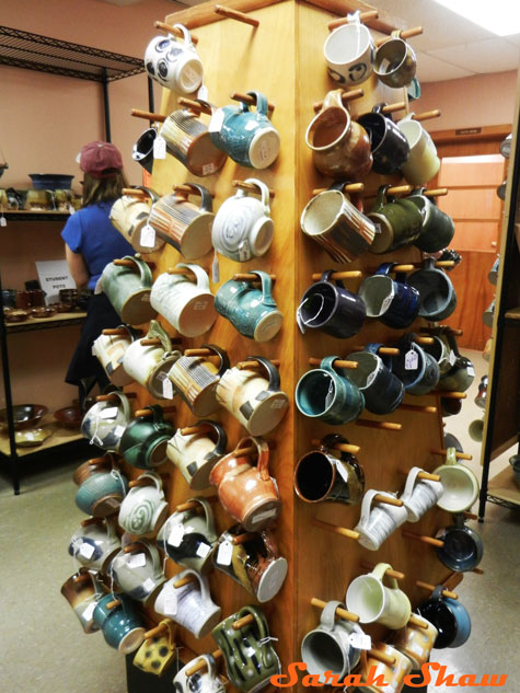 Tower of ceramic mugs at the Greater Lansing Potters Guild sale