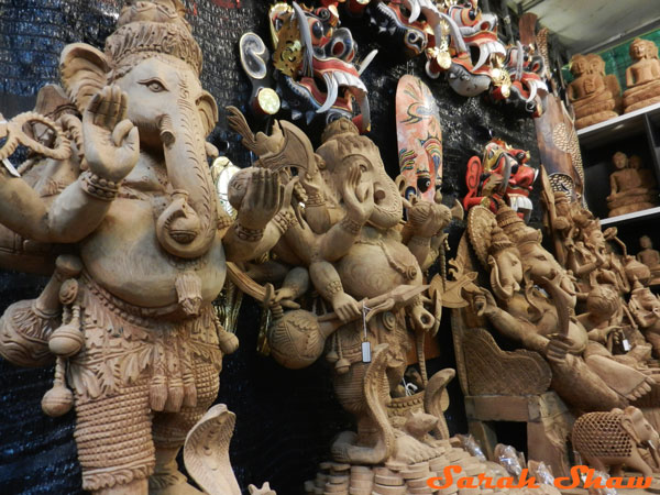 A row of wood Ganesh in the Chatuchak Weekend Market in Bangkok, Thailand
