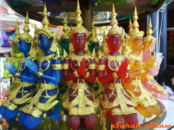 Brightly colored glass Thai figures for sale at Chatuchak Weekend Market