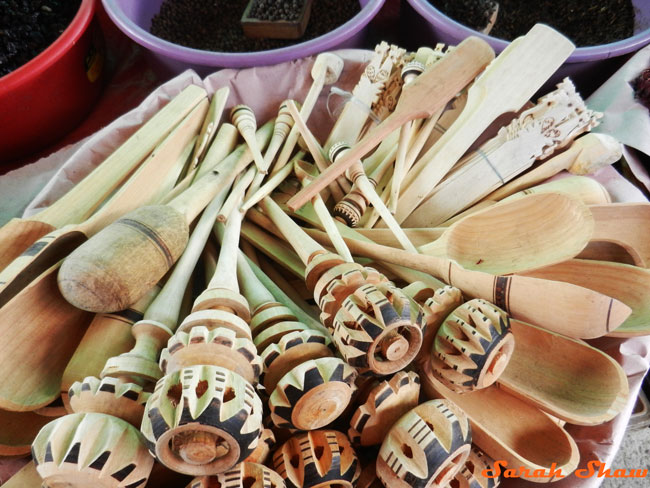 Wooden utensils, inlcuding molinillo, for sale at a local market in Oaxaca, Mexico