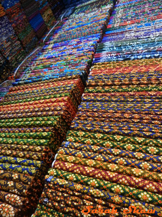 A multitude of sarongs are offered in Bangkok's Chatuchak Weekend Market