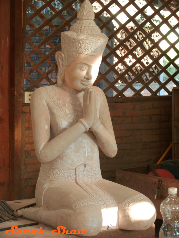 Wood carved figure from Artisans Angkor