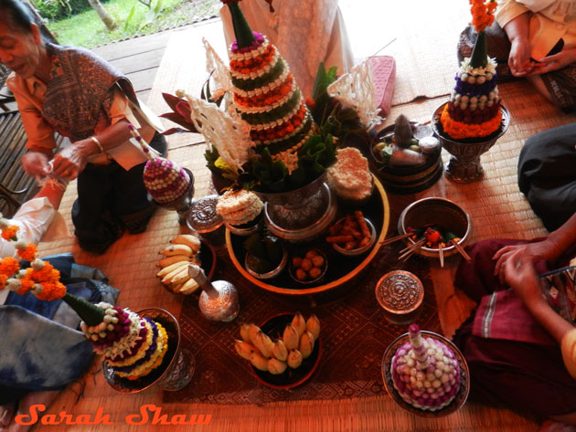 Pha khuan, or the pyramid shaped flower arrangement, in a baci ceremony