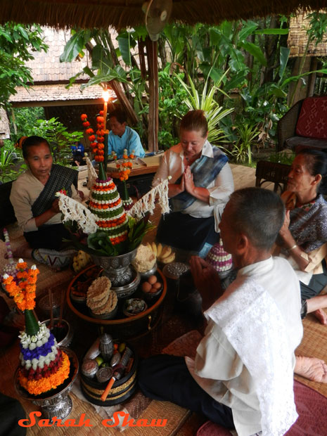 Recitations of mantras and blessings are part of a baci ceremony
