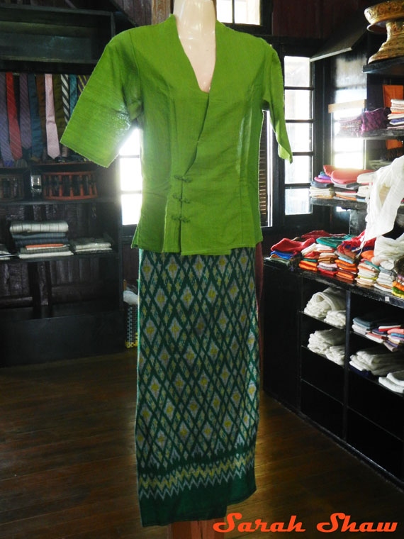 An ikat longyi is paired with a silk shirt and ready for a stylish woman in Myanmar