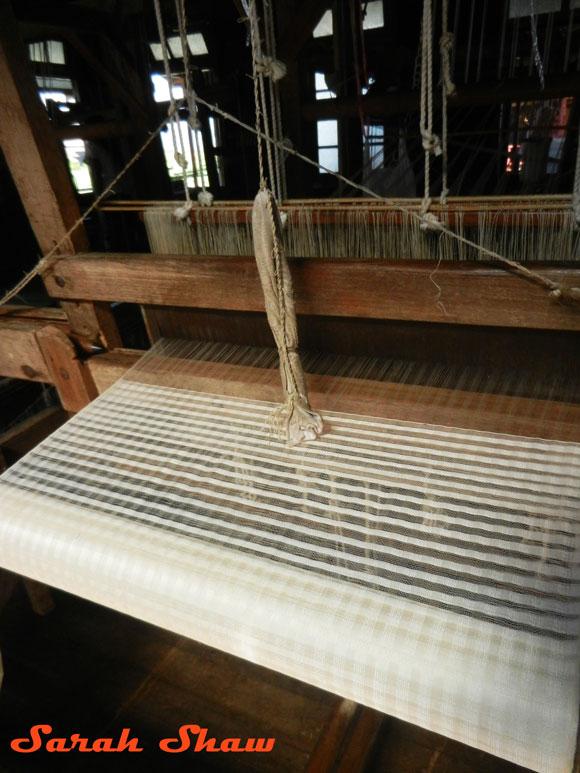 A loom weaving natural colored fiber at Khit Sunn Yin, Inle Lake, Myanmar
