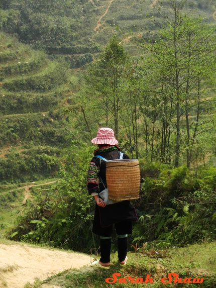 A Black Hmong woman hikes